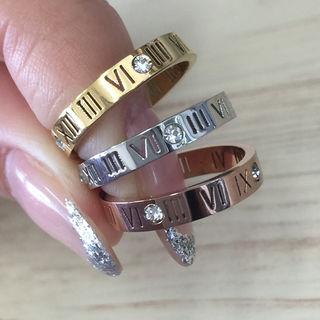 キラキラスワロチタンステンレスローマ字スケルトンリング指輪