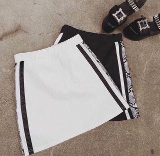 EVRIS定価7549パイソンラインスカート