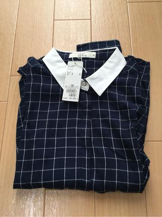 ikkaのシャツタグ付き