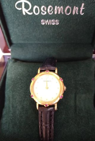 Nina Ricciダイヤルビー腕時計